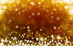 Glittery golden festive background Stock Images