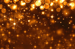 Glittery golden  holiday background Stock Photo
