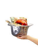 Glittery hat filled with money Royalty Free Stock Photography