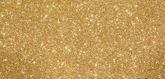 Glittery ljus skimrande bakgrund som är perfekt som en guld- backdr Royaltyfri Foto