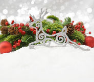 Glittery reindeer Christmas decoration in snow Royalty Free Stock Images
