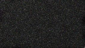 Glittery shining black texture. Glittery shining black surface. sparkling background texture for festival and celebration designs Royalty Free Stock Photography