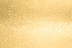 Glittery shiny lights gold abstract background Royalty Free Stock Image