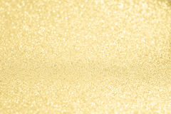 Glittery shiny lights gold abstract background Stock Photo