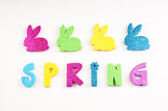 Glittery Spring with bunnies on white Royalty Free Stock Photos