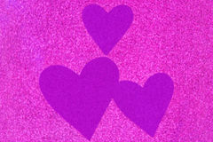 Glittery texture of glitter in magenta with blurred purple viole Stock Photography