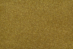 Glittery texture. Shining golden background. Gold glitter Royalty Free Stock Photo