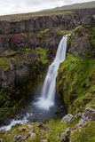 Gljúfursárfoss waterfall in eastern Iceland. Gljúfursárfoss waterfall is situated in the eastern part of Iceland near small town Vopnafjörður Stock Images