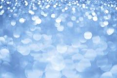 Glänzende blaue Leuchten Lizenzfreie Stockfotos