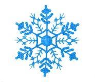 Glänzende blaue Schneeflocke Stockfotos