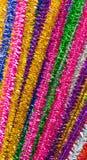 Glänzende farbige Pfeifenreiniger Stockfotografie