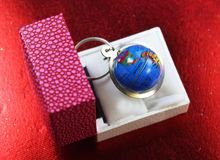 Glob key chain in a box Stock Photography