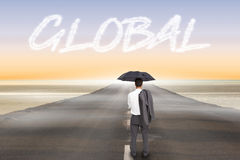Global against road leading out to the horizon Royalty Free Stock Image