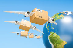 Global air mail delivery concept. Parcels with wings flying in t Stock Images