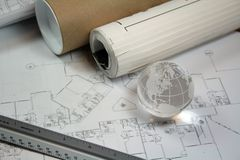 Global Architecture Concept. Glass globe with architects tools and blueprints Stock Image