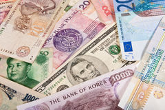 Global Banknotes. Assorted worldwide banknotes suitable for a background image Royalty Free Stock Photography