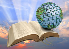 Global bible sunrise. Photo of bible with globe and sunburst sunrise ideal for religious belief,bible, Christianity etc Royalty Free Stock Photography