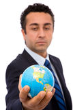Global business. Senior businessman holding a mini globe, shallow dof royalty free stock photos