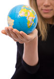 Global business. Businesswoman holding a mini globe for communications and business concepts stock photo