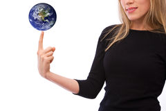Global business. Concept with a globe and businesswoman stock photography
