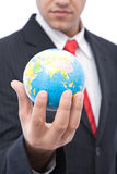 Global business. Concept with a businessman holding globe royalty free stock image