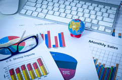 Global business charts or graphs with keyboard Royalty Free Stock Images