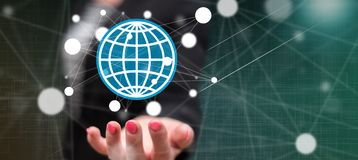 Concept of global business. Global business concept above the hand of a woman in background stock photos