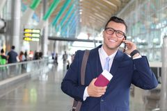 Global business concept with business man on his cell phone at the airport Royalty Free Stock Photos