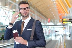 Global business concept with business man on his cell phone isolated at the airport Royalty Free Stock Photo
