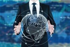 Global business concept. Businessman holding digital globe on forex background. Global business concept. 3D Rendering Stock Image