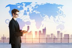 Global business concept. Businessman using laptop on abstract city background with diigtal map hologram. Global business concept. Double exposure Stock Image