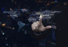 Global business concept, Elements of this image furnished by NAS. Businessman pressing global business words world map over blur colorful night light city tower Stock Photos