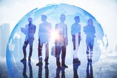 Global business and globalization concept. Businesspeople on abstract city background with globe and daylight. Global business and globalization concept. Double stock photos