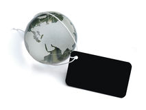 Global business label. A glass globe tied with string and blank label royalty free stock images