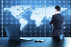Global business map. Businessman standing in modern office and looking to global business map royalty free stock image