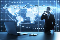 Global business map. Businessman standing in office with global business map stock photos