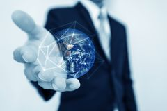 Global business and networking, Double exposure Globe with network connection lines and modern buildings, on black background. Ele. Global business and Royalty Free Stock Photo