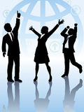 Global business people team celebrate win. A team of 3 business people, 2 men 1 woman, celebrate a worldwide win in front of globe background Royalty Free Stock Photography