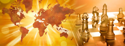 Global Business Strategy Chess. An image combining chess and a world map trying to convey global business strategy in a panorama banner Royalty Free Stock Image