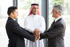 Global business team. Successful multicultural global business team hands together Stock Images
