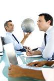 Global business is about Vision. Business meeting with CEO looking at a globe he is holding in his hand royalty free stock image
