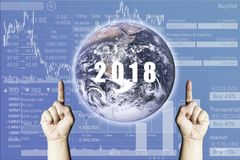 Global Business vision in 2018 with Stock Index graph on Blue Gr. Adient  Background.Image of earth furnished by NASA Stock Photo