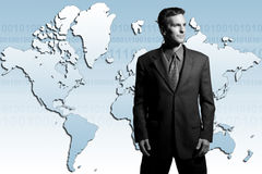 Global businessman. Businessman standing in front of world map Stock Image