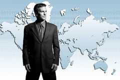 Global businessman. Businessman standing in front of world map: facing Asia and europe Stock Photography