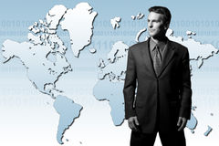 Global businessman. Businessman standing in front of world map: facing north and south america Stock Photos