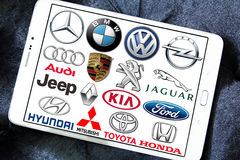 Global car brands and logos. Collection of the famous car brands logos on white tablet. Brands like mercedes , volkswagen , bmw , toyota , ford , audi , jeep Royalty Free Stock Photo