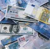 Global Cash. Cash pile of global currency notes Stock Photography