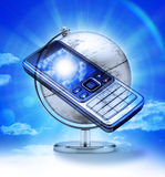 Global Cell Phone Travel. A cell phone over a world globe Royalty Free Stock Photos