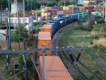 Global commerce transport in container betwen train and boat. Multimodal transport is expected to be the futur solution to the road prblems on transportation Royalty Free Stock Photo