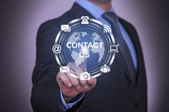 Global Communication Contact Us Concept Work on Touch Screen Royalty Free Stock Images